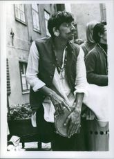 Man playing the tambourine at a Stockholm Carneval in the old city September 1970.