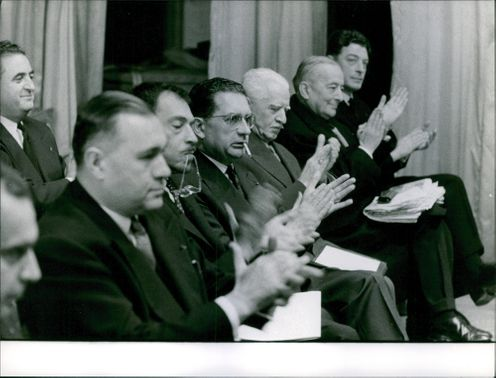 people clapping in the conference.1960
