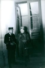 A man and a woman standing in front of the door, 1970.