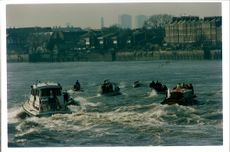Judges boat behind the athlete's boat during the Boat Race 1991