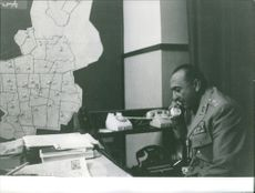 An officer talking on the telephone. June 19, 1963