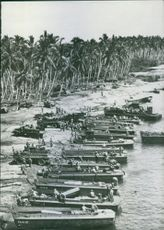 Boats lined up on the coast for passengers and transportation.