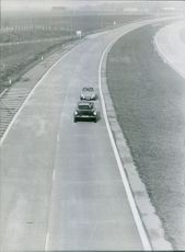 1966 Cars running on the highway.