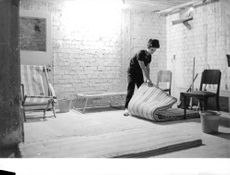 A woman folding mattress in Israel.  - 1967