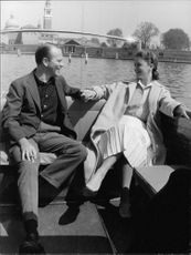 Lee Ann Remick sitting in boat with a man.