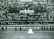 People are marching on the track, during the 1967 Summer Universiade, in Tokyo.
