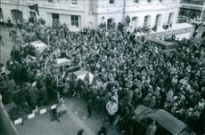 "A huge crowd gathered in front of building.   ""Robin Knox-Johnston""  1969"