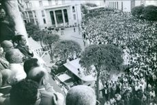Crowd are waiting for the announcement coming from the officers. 1961