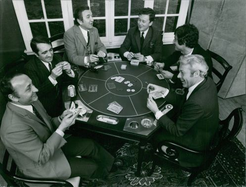 A group of men playing poker.  - Mar 1969