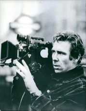 """Lord Snowdon squinting into camera during the shooting of a television documentary on old age, """"Don't Blow Outh The Candles""""."""