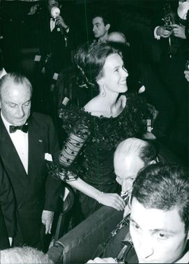 Princess Maria Gabriella of Savoy, in her black dress, looking at someone, smiling.
