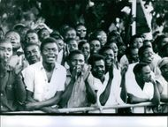 Crowds cheer for Baudouin, King of the Belgians, during his visit to Congo. 1960.