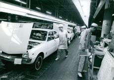 Workers working at a car factor in Tokyo, Japan.