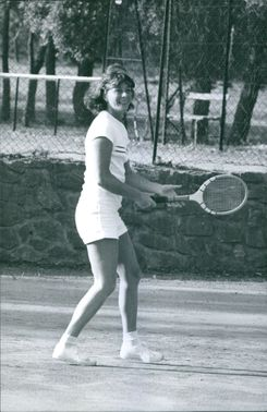 A girl plying tennis. March 7, 1964