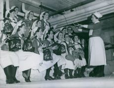 British nurses singing Christmas carol to soldiers on western front, 1939.