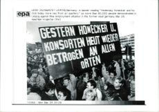 A banner reading yesterday honecker and his mob.
