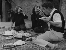 Jacques Charrier dining with two women. 1963