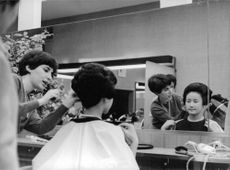 Princess Michiko preparing her hair for an occasion.
