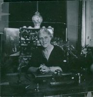 Elsa Brändström sitting on her desk.1945