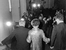 The Ducal couple of Windsor getting down the stairs, in rear view, with photographers taking pictures, 1966.