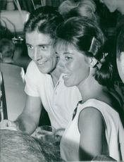 Sacha Distel having a good time with his wife.