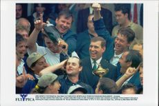 Golf player Nick Faldo pour champagne over caddin Billy Foster along with his team and Prince Andrew at the award ceremony in the Ryder Cup 1997