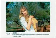 German tennis player Steffi Graf in South Africa with lion tongue