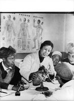 Chinese woman describing heart disease to Tibet's people.