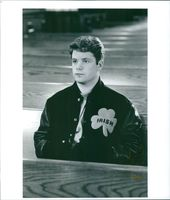 Sean Astin is sitting inside the church.