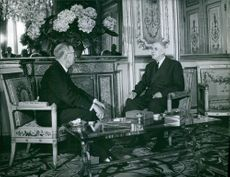 Charles de Gaulle having discussion with the king of Sweden Gustaf VI Adolf of Sweden during his visit in Paris