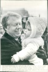 President Jimmy Carter holds year-old Lori Schwarts when he met wellwishers outside the White House