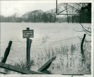 Floods 1966-1989:A field under water.