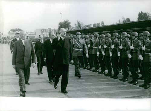 Charles De Gaulle is giving salute to the officers. July 10, 1963