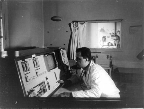 A doctor monitoring a patients condition. 1966.