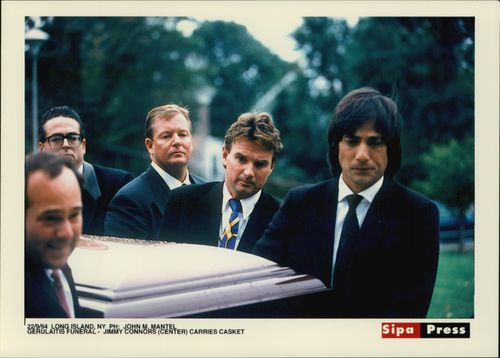 Jimmy Connors (in the middle) carries the coffin at Vitas Gerulait's burial on Long Island