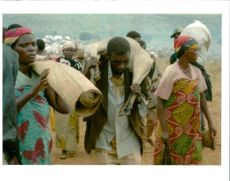 The Rwandan War:Rwandan refugees laden with their earthly.