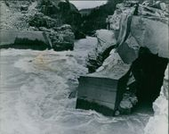 A Tunnel blasted through solid rock to allow the salmon through a quiet waterway to the baffle.