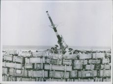 An Anti Aircraft gun position inside Tobruk protected by Italian Ammunition boxes filled with stones.