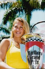 Anna Kournikova wins a tennis tournament in Florida.
