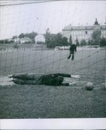 Footballers playing football, goalkeeper trying to save the goal, diving during training.1942