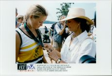 Queen Silvia delivers medallion to Ingela Ericsson during the Olympic Games.