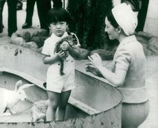 Crown Princess Michiko with Prince Aya at the Zoo, the prince was held in a kinkajou