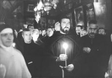 A man standing with candle in his hand.