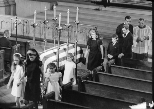 People passing by Robert F. Kennedy's coffin.