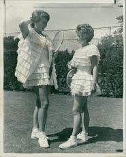 Mrs. Pat Edrich and Miss Mimi Arnold: who wore a dress with layers of lace