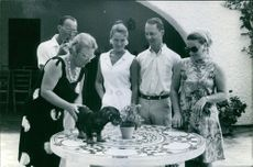 Queen Juliana with her family enjoying and smiling.