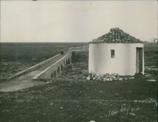 A built structure beside of the bridge during Balkan wars , 1913.