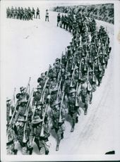 Colonial troops marching in the street, 1940.