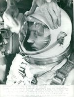 Astronaut James McDivitt in his spacecraft in front of space shuttle with Gemini-4