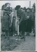 "Woman digging the soil, while other people looking at her.  ""Poland-Germany war civil population""  1939"